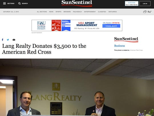 Lang Realty present check to american red cross